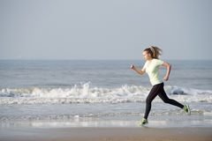 Female running by the sea Royalty Free Stock Images