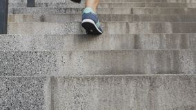 Female running up staircase to achieve goals and dreams, searching for success. Stock footage stock video footage