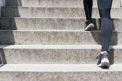 Female running up stairs. Close up of a female legs running up stairs Royalty Free Stock Images