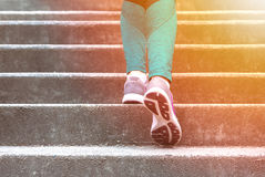 Female running up stairs royalty free stock photo