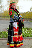 Female Russian national costume. Tambov, Russia, October 12, 2013: The traditional autumn fair Pokrovskaya. Female Russian national costume of the Tambov royalty free stock photos