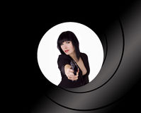 Female Russian Spy. Female spy pointing a gun at you Royalty Free Stock Photo