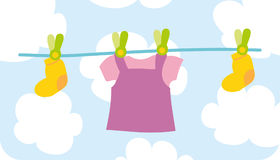 Female's baby cloth. Child's clothes are drying after washing Stock Photo