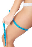 Female's buttock with measuring tape. Isolated on white stock images