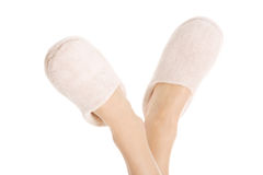 Female's feet with white slippers. Royalty Free Stock Photos