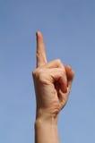 Female's hand. Hand, forefinger, sign, ides, blue, sky, female Stock Photos