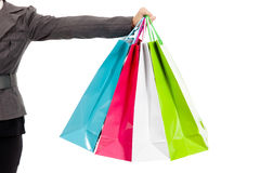 Female s hand holding colorful shopping bags Stock Photos