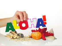 Female's hand holding colorful word 'Aloha' Stock Photo