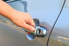 Female's hand opening a car door. Stock Photo