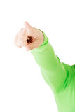 Female's hand pointing on copy space. Royalty Free Stock Photography
