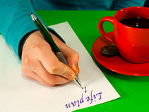 Female's hand writing a life plan Stock Image