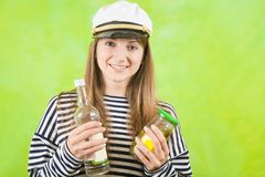 Female sailor with bottle of vodka Stock Photography
