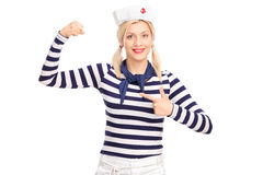 Female sailor flexing her bicep Stock Photo