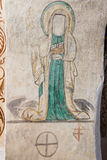Female Saint and ancient marks in the church arch Stock Image