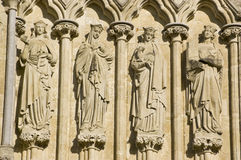 Female Saints, Salisbury Cathedral. Statues of Saints Lucy, Agatha, Agnes and Cecilia on the West Front of Salisbury Cathedral, Wiltshire.  Sculpted by James Royalty Free Stock Image