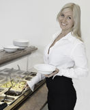 Woman at salad bar. Young woman ready to choose from salat bar royalty free stock photography