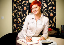 Female sales assistant Royalty Free Stock Image