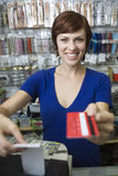Female Sales Assistant At Cash Counter Stock Photos