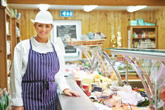 Female Sales Assistant In Delicatessen Royalty Free Stock Photo
