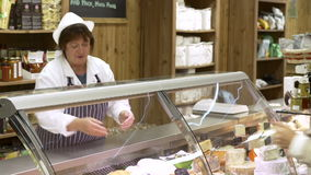 Female Sales Assistant Serving Customer In Delicatessen stock footage