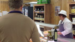 Female Sales Assistant Serving Customer In Delicatessen stock video footage