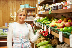 Female Sales Assistant At Vegetable Counter Of Farm Shop Stock Photography