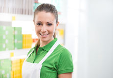 Female sales clerk working at supermarket Royalty Free Stock Images