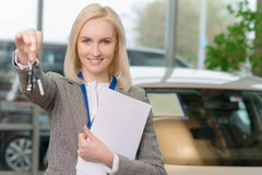 Female sales representative is upholding the car Royalty Free Stock Photo