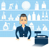 Female salesman with cashier Royalty Free Stock Images