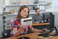 Female salesperson holding electrical product royalty free stock photography