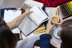 Female saleswoman, interior designer in showroom stock photography