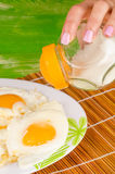 Female salting eggs Stock Photography