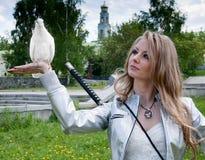 Female with samurai sword and dove Stock Photos