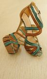 Female sandals. Pair of female sandals on a high heels Royalty Free Stock Photo