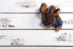Female sandals on wooden shelf. Royalty Free Stock Image