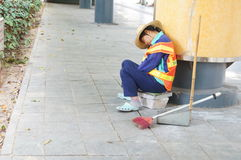 A female sanitation workers in the sleepy, in Shenzhen, China Royalty Free Stock Images
