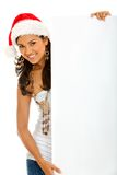 Female Santa with a banner Stock Images