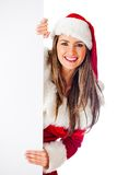 Female Santa with a banner Stock Photography