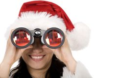 Female santa with binoculars Royalty Free Stock Photos