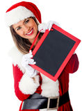Female Santa with a blackboard Royalty Free Stock Photos