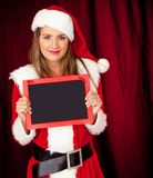 Female Santa with a blackboard Royalty Free Stock Image