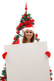 Female Santa with blank sign Royalty Free Stock Photos