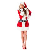 Female Santa blowing kisses Royalty Free Stock Images