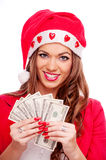 Female Santa with cash Royalty Free Stock Photography