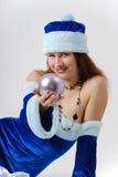 Female Santa with christmas ball Royalty Free Stock Photos