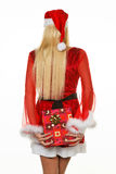 Female Santa Claus brings gifts. Young woman dressed as Santa Claus holding gift package Royalty Free Stock Images