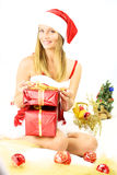 Female santa claus with gifts for christmas Royalty Free Stock Photos
