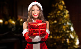 Female Santa Claus giving you a present Royalty Free Stock Image