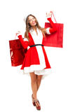 Female Santa Claus giving you a present Stock Image