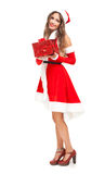 Female Santa Claus giving you a present Stock Images